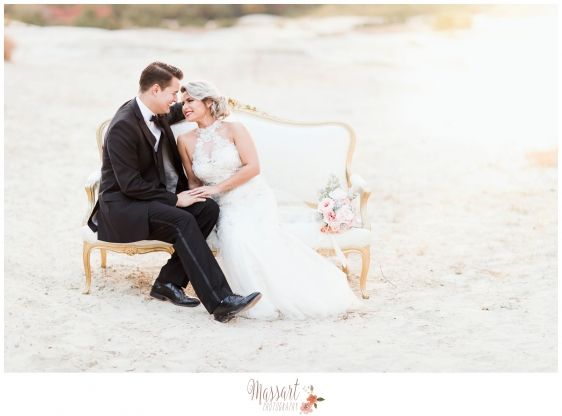 Outdoor beach wedding portrait of bride and groom on a vintage love seated photographed by Massart Photography RI MA CT
