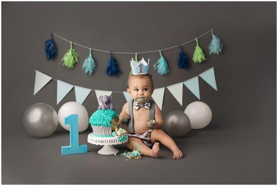 A gray and blue elephant cake smash first birthday studio baby portrait with Rhode Island photographers of Massart Photography RI, CT, MA