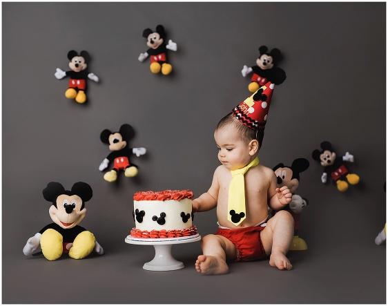 A Mickey Mouse Disney themed cake smash 1st birthday studio baby portrait with Rhode Island photographers of Massart Photography RI, CT, MA