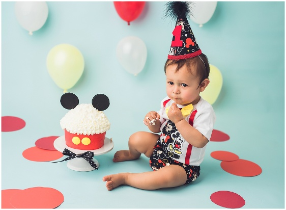 A Mickey Mouse Disney themed cake smash first birthday studio baby portrait with Rhode Island photographers of Massart Photography RI, CT, MA