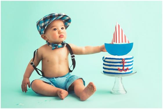 A nautical blue cake smash first birthday studio baby portrait with Rhode Island photographers of Massart Photography RI, CT, MA