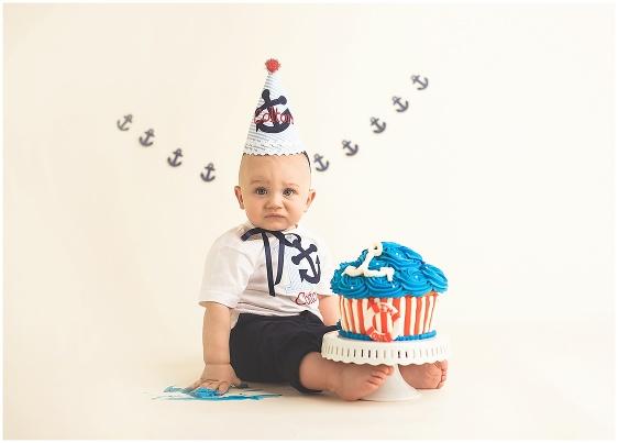 A nautical sailor cake smash first birthday studio baby portrait with Rhode Island photographers of Massart Photography RI, CT, MA