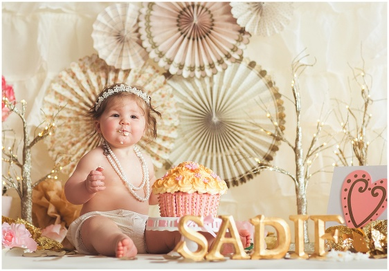 A pink and gold cake smash first birthday studio baby portrait with Rhode Island photographers of Massart Photography RI, CT, MA