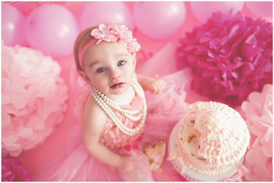 A pink and pearls cake smash first birthday studio baby portrait with Rhode Island photographers of Massart Photography RI, CT, MA