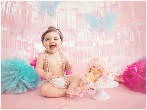 A pink and blue butterfly cake smash first birthday studio baby portrait with Rhode Island photographers of Massart Photography RI, CT, MA