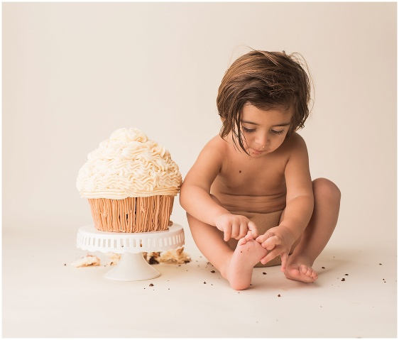 A simple neutral cake smash first birthday studio baby portrait with Rhode Island photographers of Massart Photography RI, CT, MA