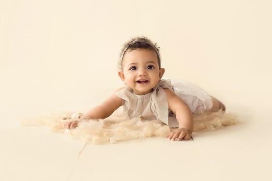 Classic neutral colors milestone baby photo in studio at Massart Photography RI
