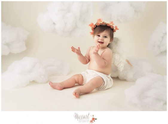 Timeless baby milestone portrait with clouds angel wings and flower crown taken in studio by Rhode Island family photographers at Massart Photography CT RI MA