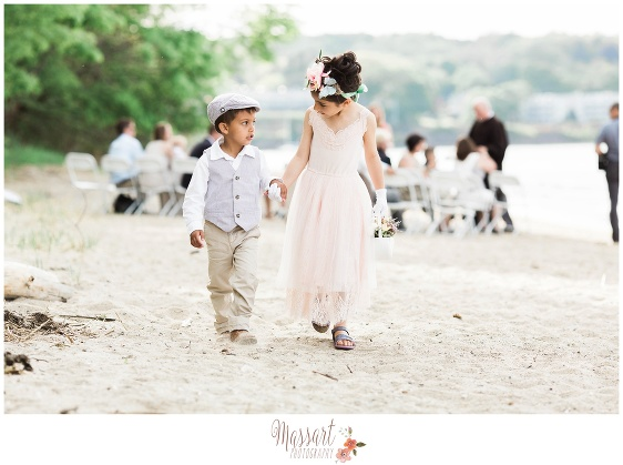 Picture of flower girl and ring bearer on the beach during Goddard Park wedding photographed by Massart Photography RI MA CT