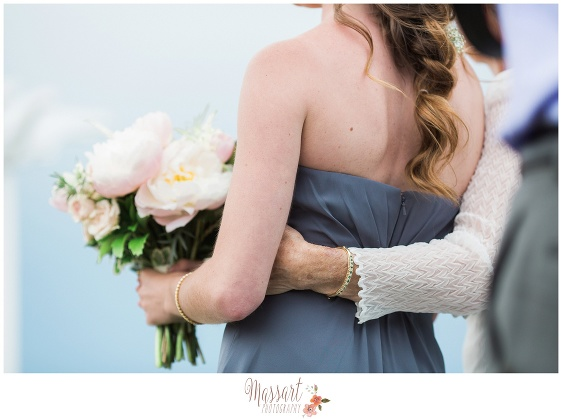 Photo of bridesmaid during wedding ceremony at Oceancliff in Newport Rhode Island photographed by Massart Photography RI MA CT