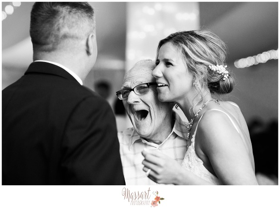 Black and white pic of bride and groom with guest during wedding reception at Five Bridge Inn in Massachusetts photographed by Massart Photography RI MA CT