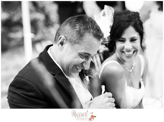 Black and white candid portrait of bride and groom photographed at Blithewold Mansion in Bristol Rhode Island by Massart Photography RI MA CT