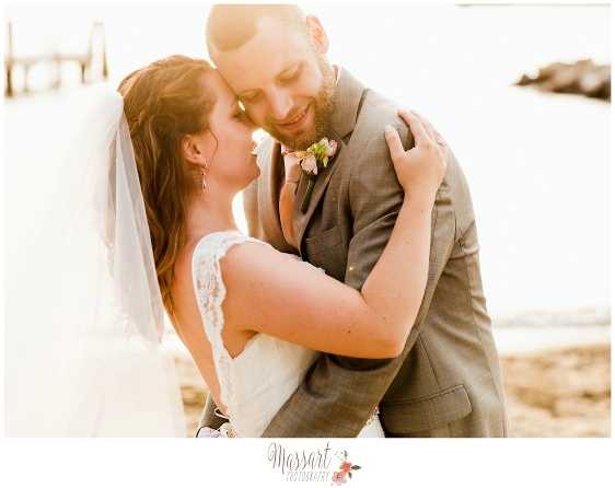 Outdoor beach portrait of bride and groom captured by Rhode Island photographer of Massart Photography RI MA CT