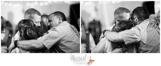 Black and white photos of family embracing during wedding reception photographed by Massart Photography of Warwick RI