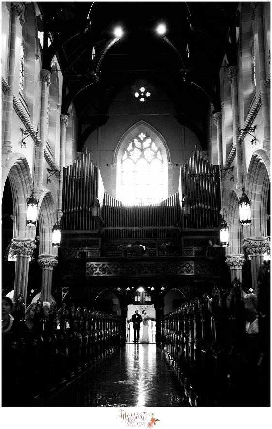 Black and white pic of bride and father entering the church for the ceremony photographed by Massart Photography RI MA CT