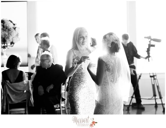 Black and white photo of bride and wedding guests captured by Rhode Island photographers of Massart Photography RI MA CT