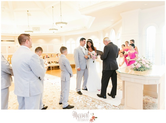 Wedding ceremony photo of bride and groom with bridal party taken inside the wedding pavilion at Walt Disney World by Massart Photography of Warwick Rhode Island