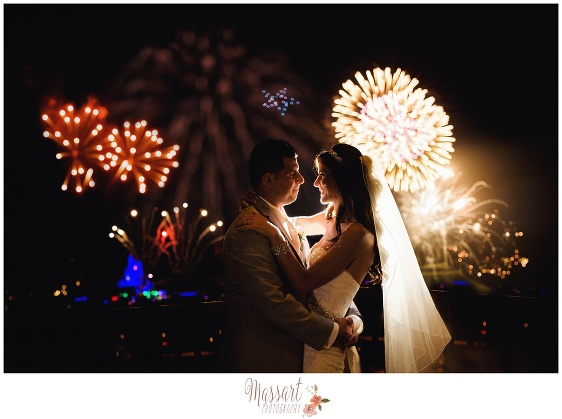 Portrait of bride and groom kissing with fireworks and Cinderella