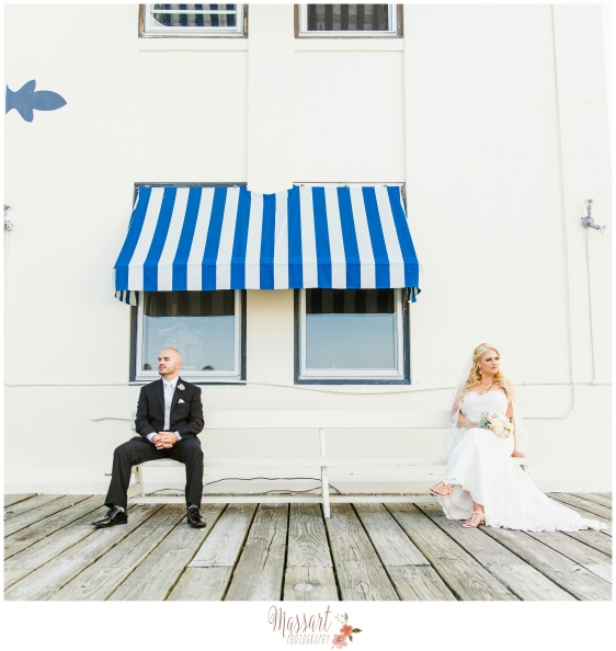 Outdoor pic of bride and groom on the docks at Regatta Place in Newport Rhode Island taken by Massart Photography RI MA CT