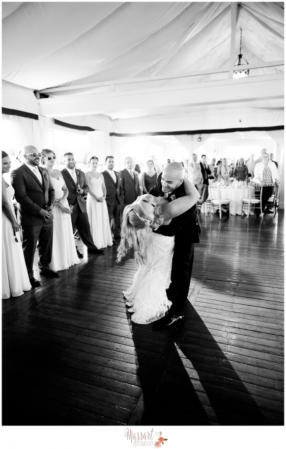 Black and white portrait of bride and groom first dance dip at Regatta Place in Newport Rhode Island by Massart Photography RI MA CT
