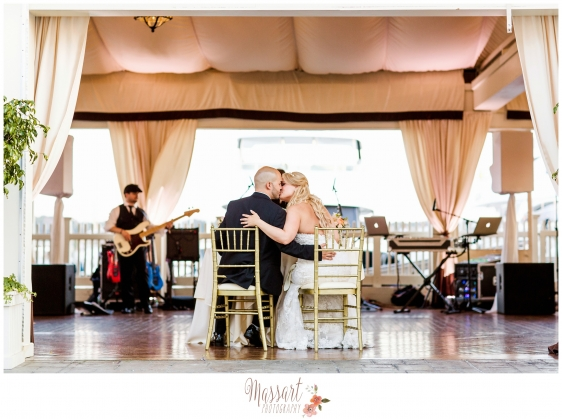 Bride and groom kissing on the dance floor with live band at reception photographed by Massart Photography RI MA CT