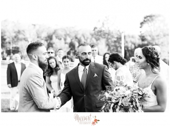 Black and white portrait of father of bride handing her off to the groom captured by Massart Photography of RI