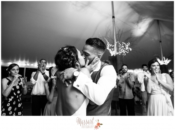 Black and white portrait of bride and groom dancing and kissing during reception photographed by Massart Photography RI MA CT