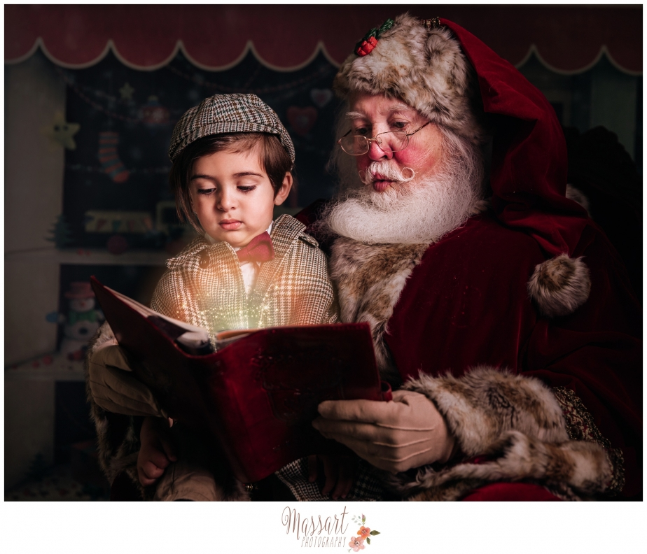 boy poses with santa for a holiday portrait with massart photography in their warwick portrait studio RI