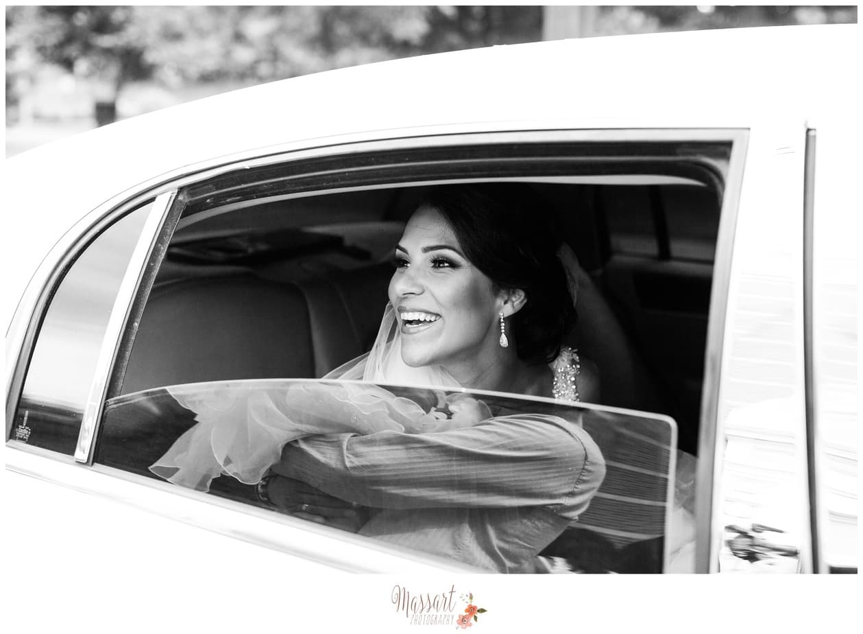 bride in limousine before church ceremony RI