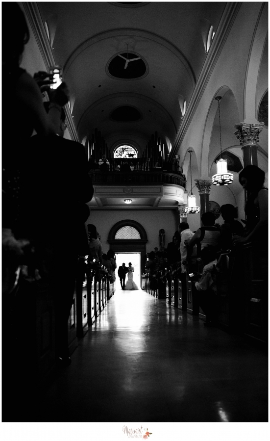 Black and white portrait of bride and father of the bride entering church for wedding ceremony photographed by Rhode Island photographer of Massart Photography RI MA CT