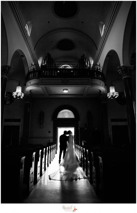 Black and white portrait of bride and groom exiting the church after wedding ceremony at Saint Ann church photographed by Warwick Rhode Island photographers of Massart Photography RI MA CT