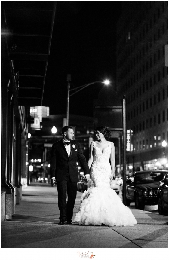 Black and white outdoor portrait of bride and groom in downtown Providence RI on their wedding day photographed by Warwick Rhode Island photographers of Massart Photography RI MA CT