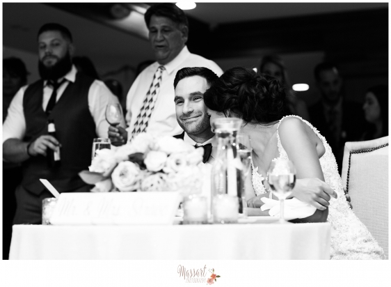 Black and white picture of bride and groom at their sweetheart table at their wedding reception on their wedding day photographed by Warwick Rhode Island photographers of Massart Photography RI MA CT
