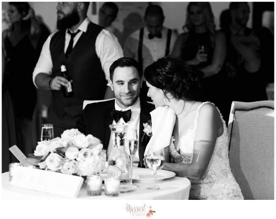Black and white photos of bride and groom at sweetheart table at wedding reception on their wedding day photographed by Rhode Island photographers of Massart Photography RI MA CT