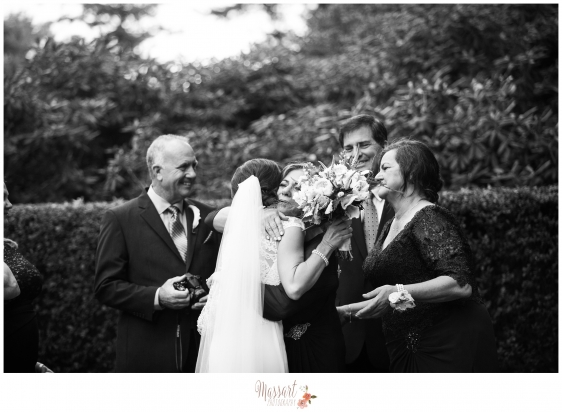 Black and white outdoor family wedding day photo photographed by Rhode Island photographers of Massart Photography MA RI CT