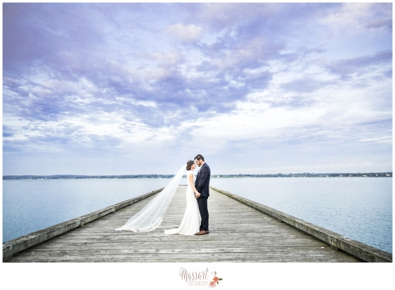 Outdoor Glen Manor wedding day portrait on the dock of bride and groom photographed in Portsmouth Rhode Island by Warwick Rhode Island photographers of Massart Photography MA RI CT