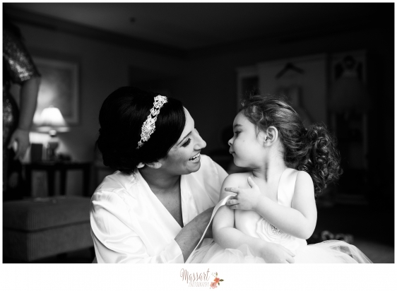 Black and white pic of flower girl and bride getting dressed photographed by Warwick Rhode Island photographers of Massart Photography MA RI CT