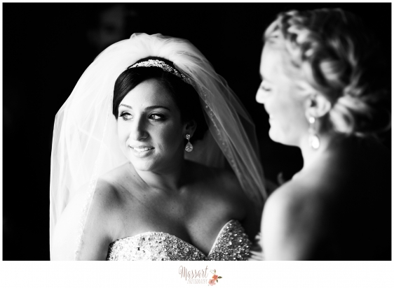 Black and white portrait of bride in her wedding dress and veil with bridesmaid photographed by Warwick Rhode Island photographers of Massart Photography MA CT RI
