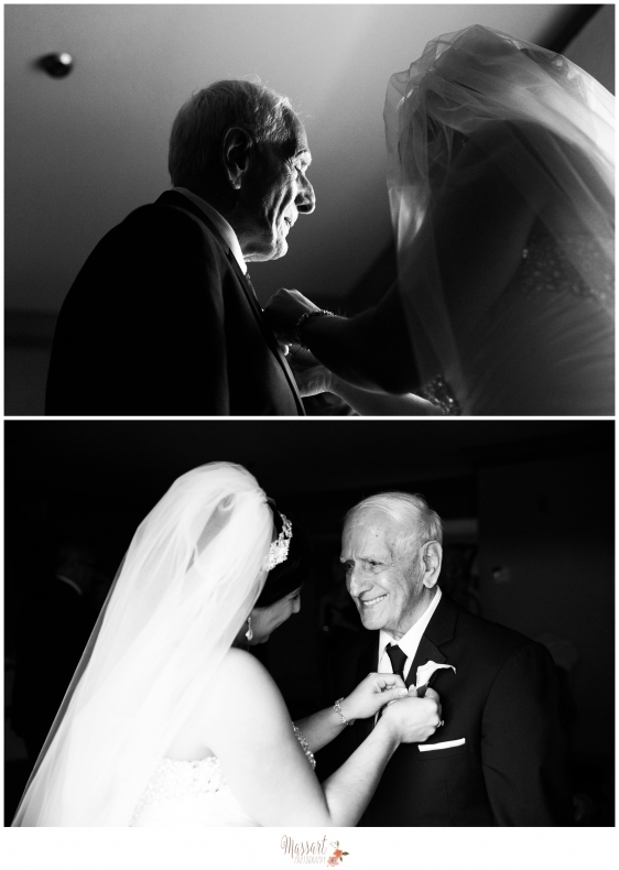 Black and white portrait of bride pinning grandfather