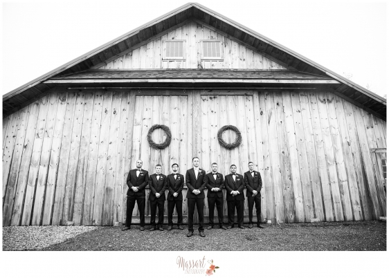 Black and white photo of groom and groomsmen in tuxes taken at Blissful Meadows in Massachusetts photographed by Rhode Island photographers of Massart Photography MA CT RI
