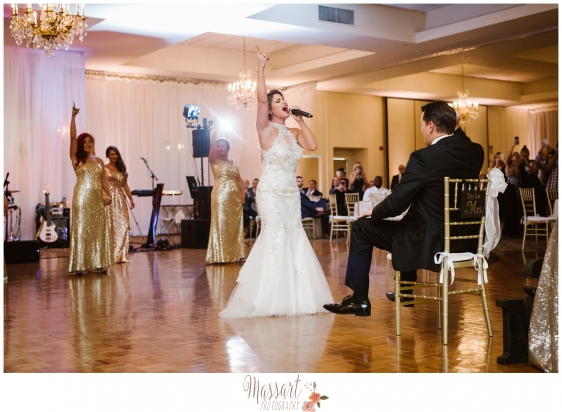 Portrait of bride performing for groom on wedding day taken by Warwick Rhode Island photographers of Massart Photography MA RI CT