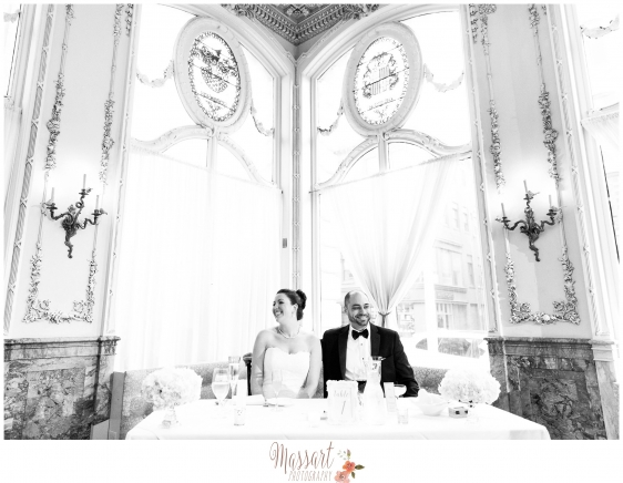 Black and white portrait of bride and groom at their sweetheart table photographed by Rhode Island photographers of Massart Photography RI MA CT
