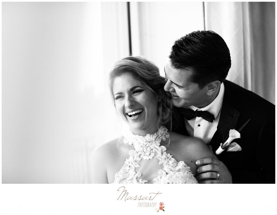 Black and white wedding day portrait of bride and groom photographed by Massart Photography of RI
