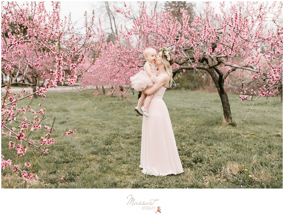 Portrait of mother and daughter with flowering trees photographed by Massart Photography of Rhode Island.