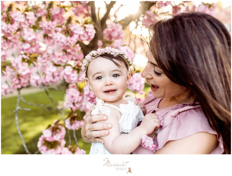 Mother and daughter outdoor spring portrait under a cherry blossom tree photographed by Massart Photography of Warwick, RI
