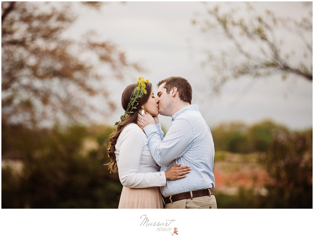 Portrait of an engaged couple kissing photographed by Massart Photography, RI MA CT.