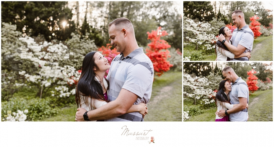 An engagement photo shoot with flowering bushes and trees photographed by Massart Photography, RI MA CT