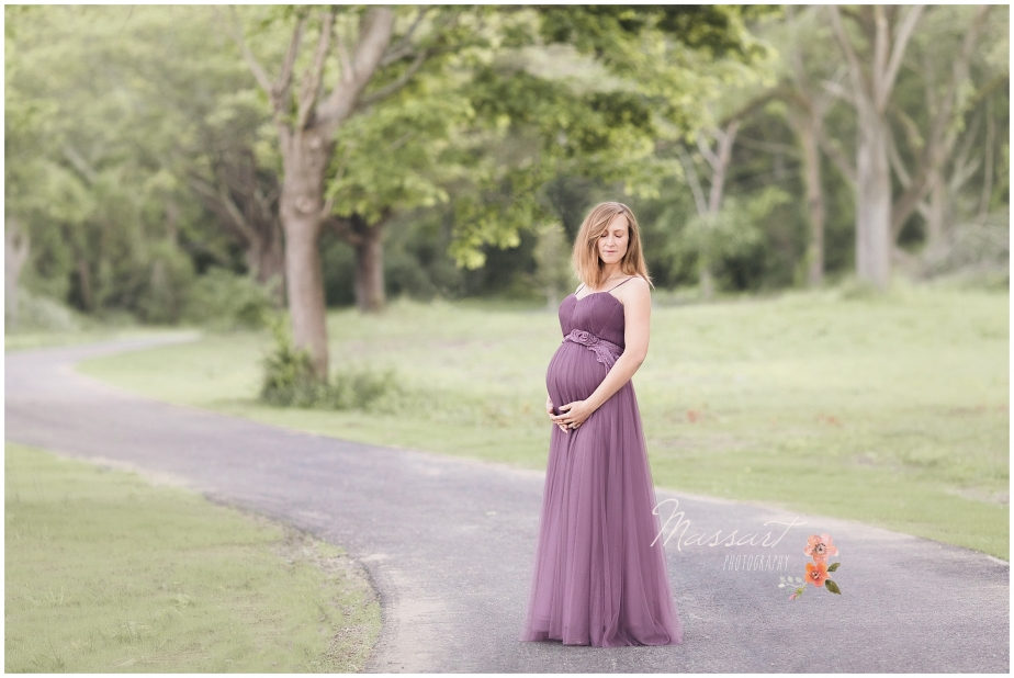 spring maternity portrait on a wooded path