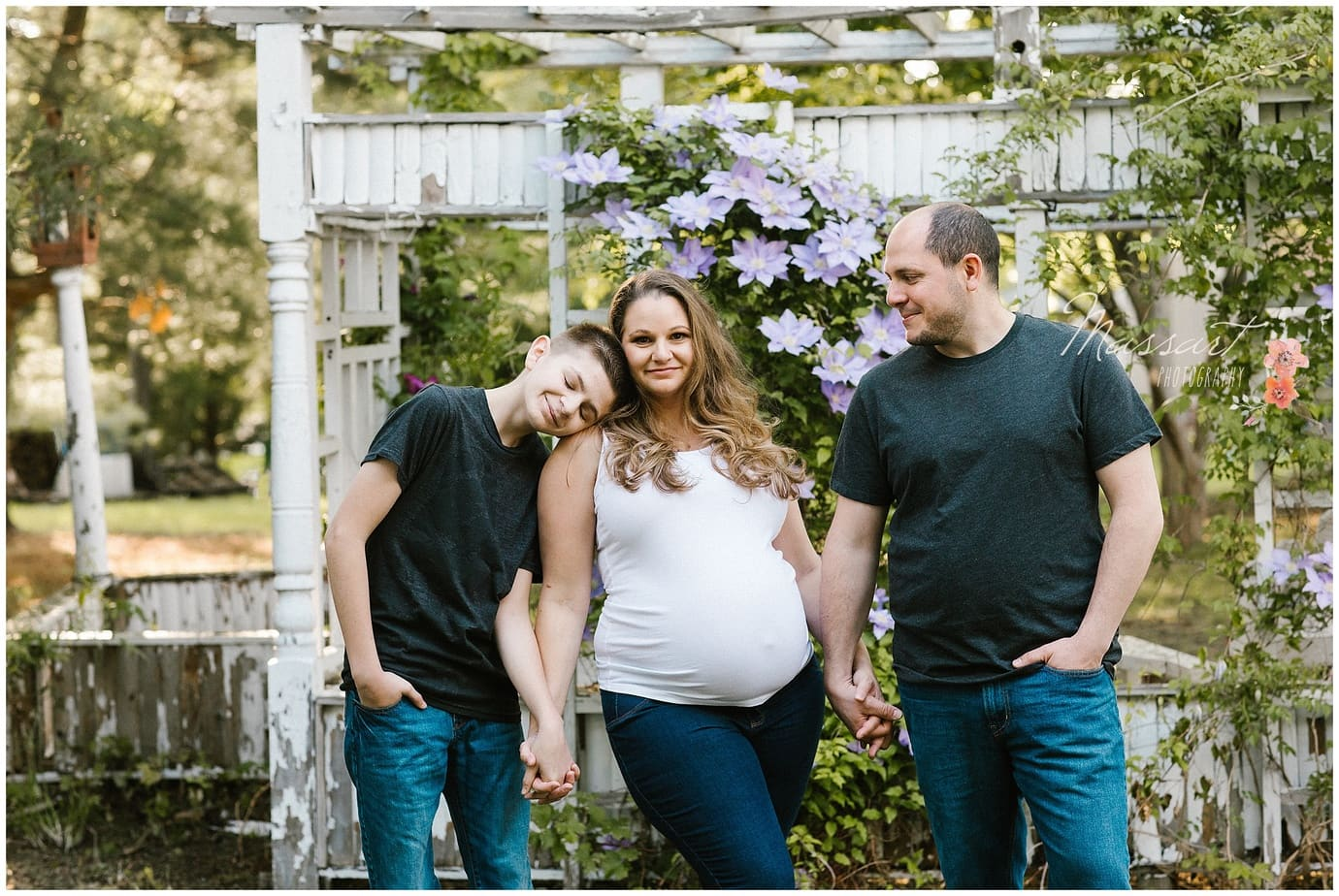 Outdoor family maternity photo shoot photographed by Massart Photography of Rhode Island.