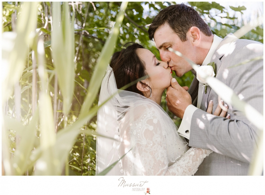 wedding photo of the bride and groom kissing photographed by massart photography of rhode island